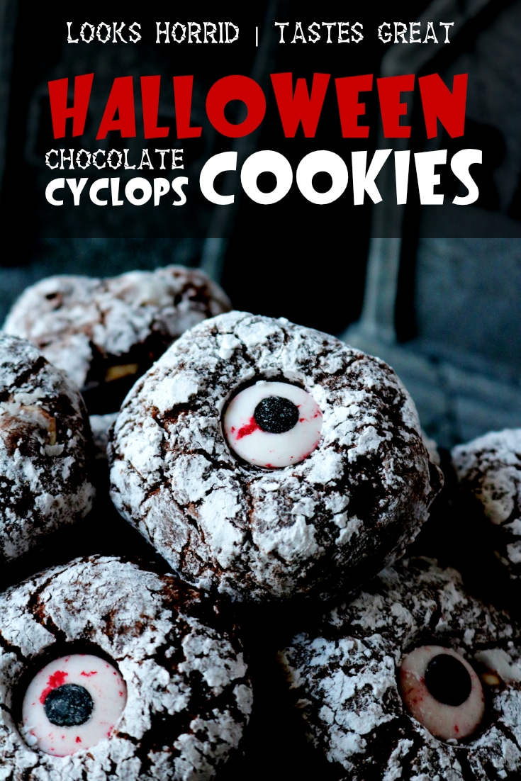 A Halloween cookie recipe, featuring an easy and delicious brownie-like cookie with powdered sugar and spooky candy eyes. #halloweendesserts #halloweentreats #halloweenfoodforkids #halloweenfoodforaparty #easyhalloweenrecipes #trunkortreating #halloweenrecipes #halloweenfood #halloweenpartyfood #halloween #creepyhalloweenfood #halloweencookies