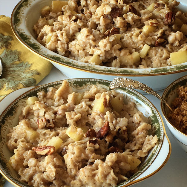 A hearty and warming homemade, cinnamon-spiced oatmeal featuring apples and chopped pecans.