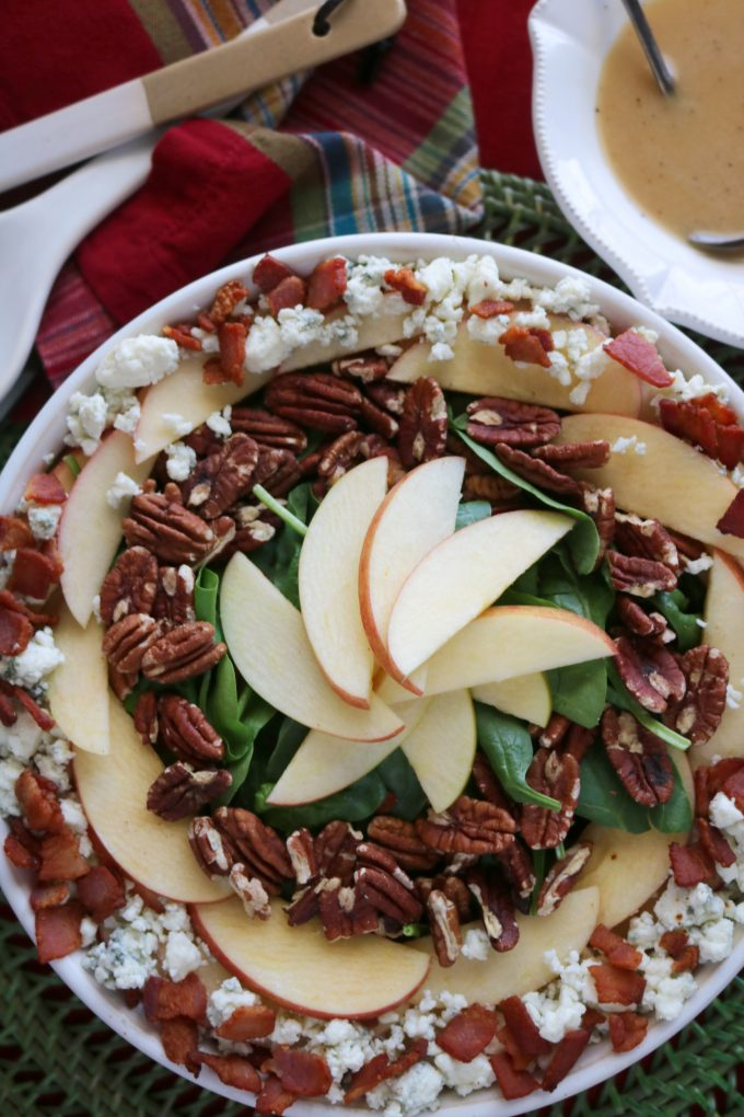 A fall salad featuring apples, bacon, blue cheese and a maple dijon dressing.