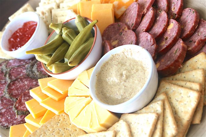 A combination of cheeses, cured meats and accouterments perfect for game day entertaining.