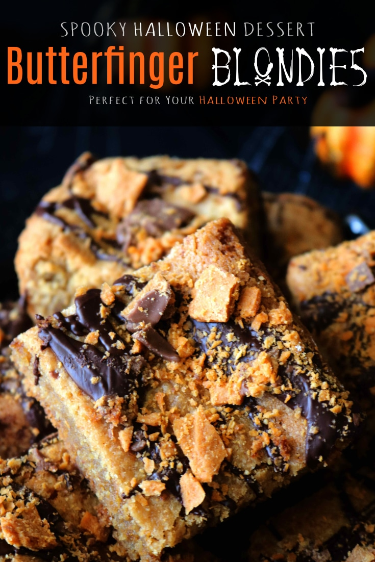 A Halloween treat recipes featuring Halloween Blondies decked out with peanut butter, crushed Butterfinger candy, and a drizzle of dark chocolate. #halloween #halloweenfood #halloweenrecipes #partyfood #halloweendessert #easydessertrecipes #peanutbutterblondies #blondies