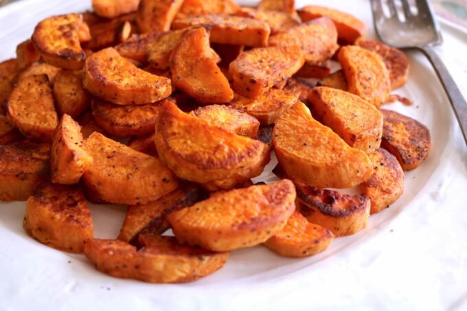 Easy recipe featuring sweet potatoes crescents seasoned with smoked paprika and roasted.