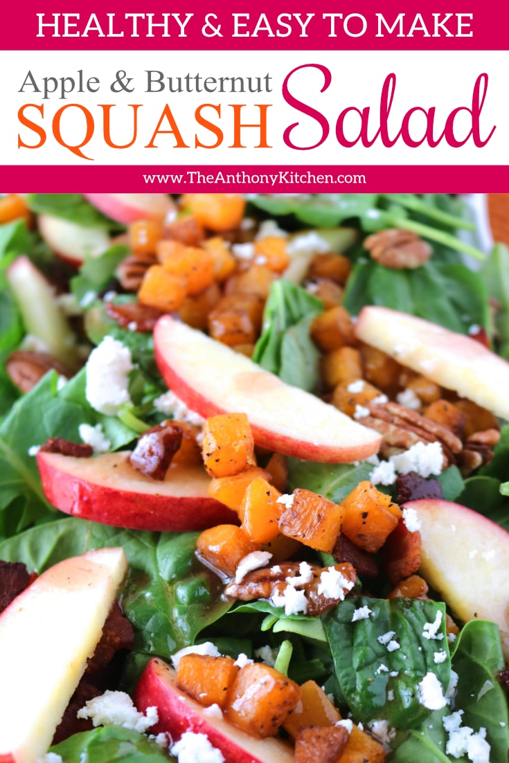 An easy butternut squash recipe featuring a power greens salad with roasted butternut squash, apples, bacon, pecans, goat cheese with a warm bacon-raspberry vinaigrette. #fallrecipes #fallsalad #saladrecipes #healthyfallrecipes #healthyrecipes #salad #saladrecipe #applesalads #butternutsquash #butternutsquashrecipes