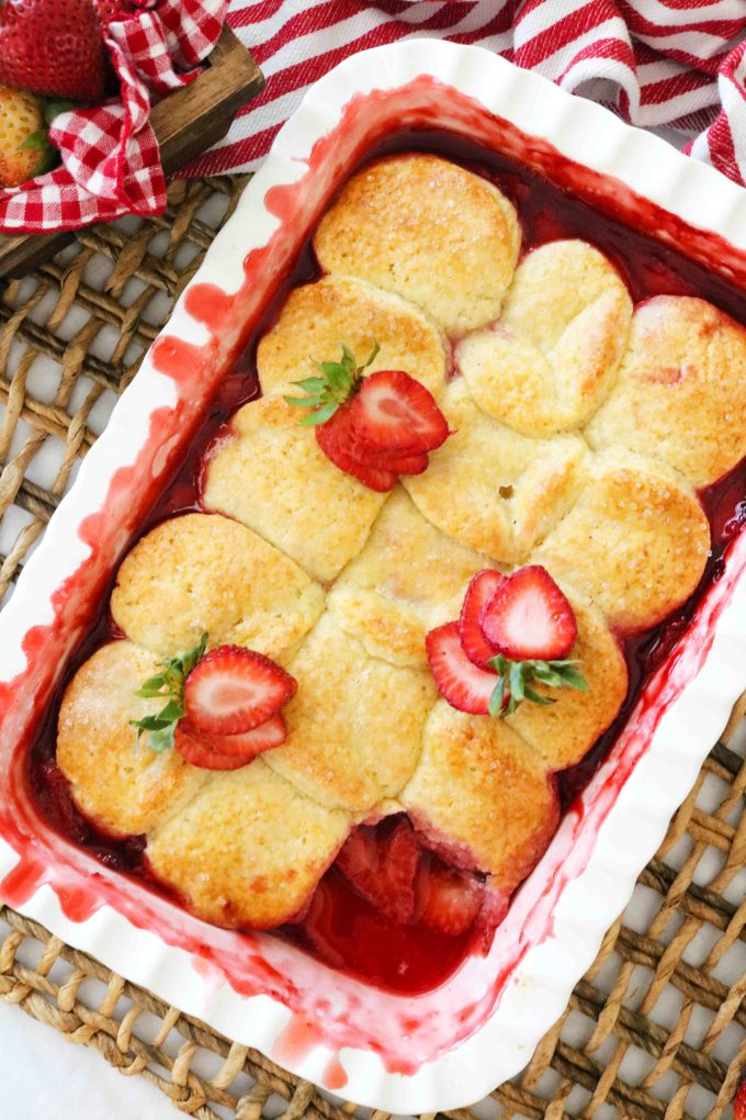An overhead shot of Strawberry Cobbler topped with sliced fresh strawberries.