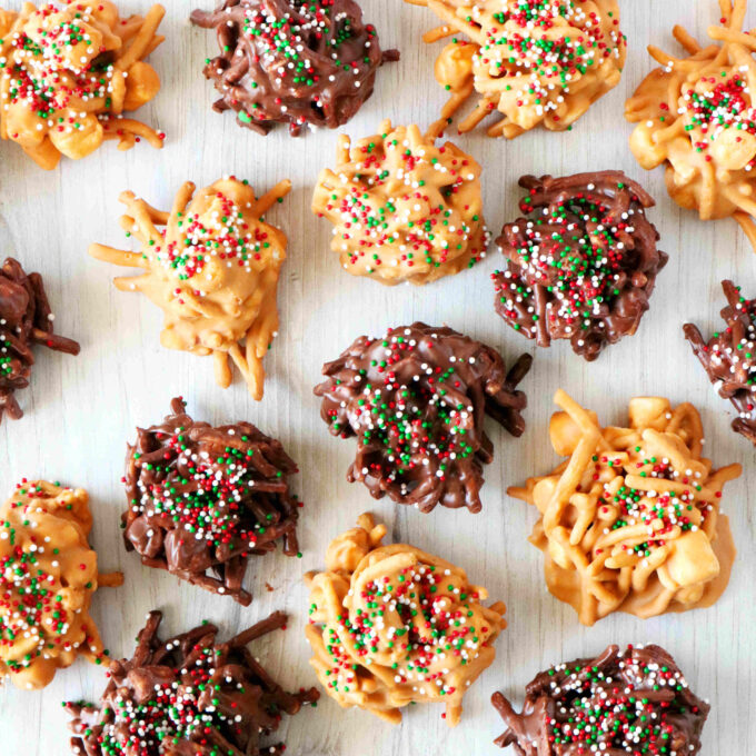 An overhead shot of chocolate and butterscotch haystack cookies with sprinkles on top.
