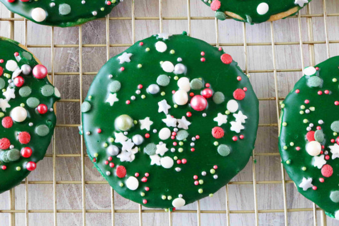 An overhead shot of a cookie with sugar cookie icing and sprinkles.