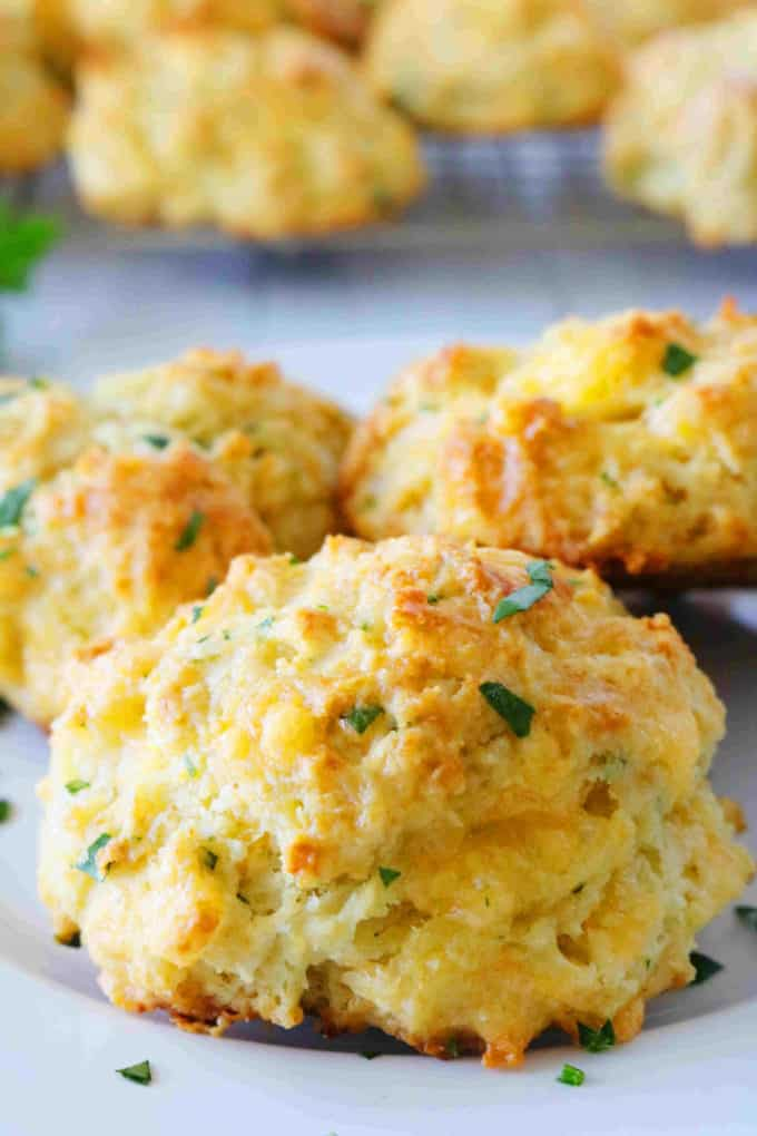 A close-up shot of Red Lobster Cheddar Bay Biscuits sprinkled with parsley.