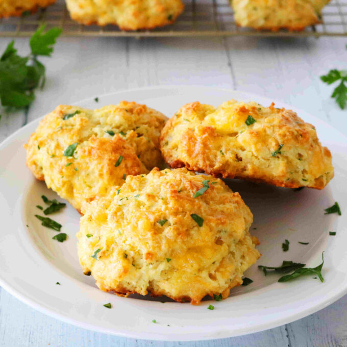 Three Cheddar Bay Biscuits stacked on a plate.