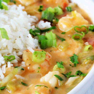 A close up shot of etouffee loaded with shrimp.