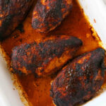 An overhead shot of Blackened Chicken Breasts in a pan.
