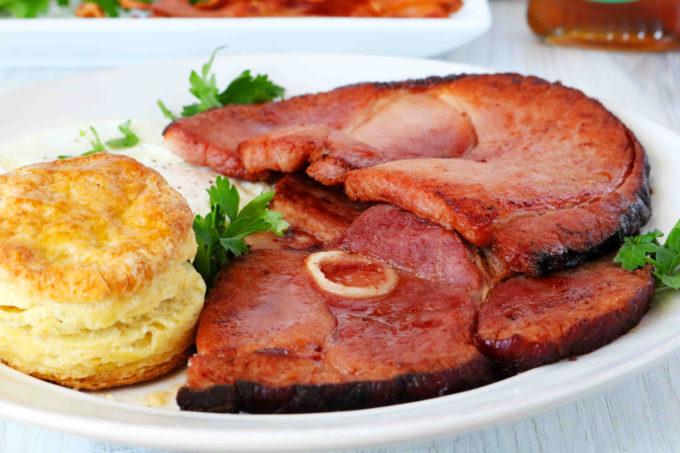 A close up shot of bone-in ham steaks.