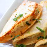 A close up shot of Tacos Dorados de Papa (Potato Tacos) on a platter.