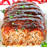 A front view of sliced BBQ Meatloaf topped with BBQ Glaze.