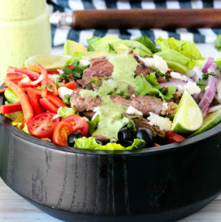 Fajita Salad topping with a creamy cilantro lime dressing.