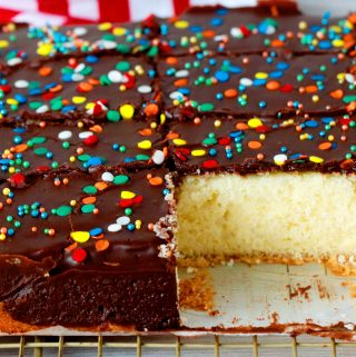 Yellow Cake with Chocolate Frosting that has been cut into slices.