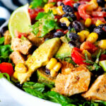 A close up shot of avocado, corn, and black beans in a Southwest Chicken Salad.