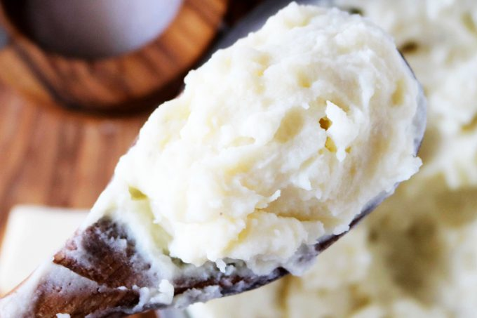 Mashed potatoes on a wooden spoon.