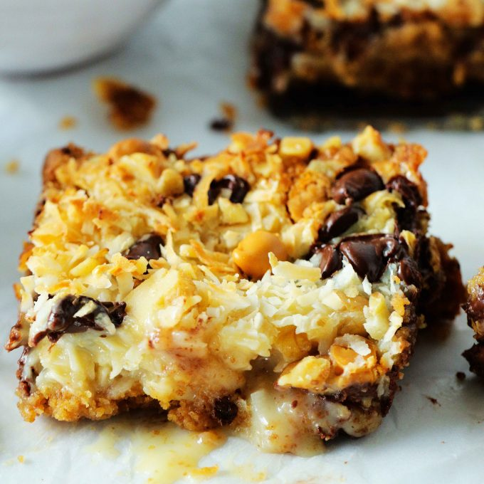 A 7 Layer Bar Cookie on a parchment paper.