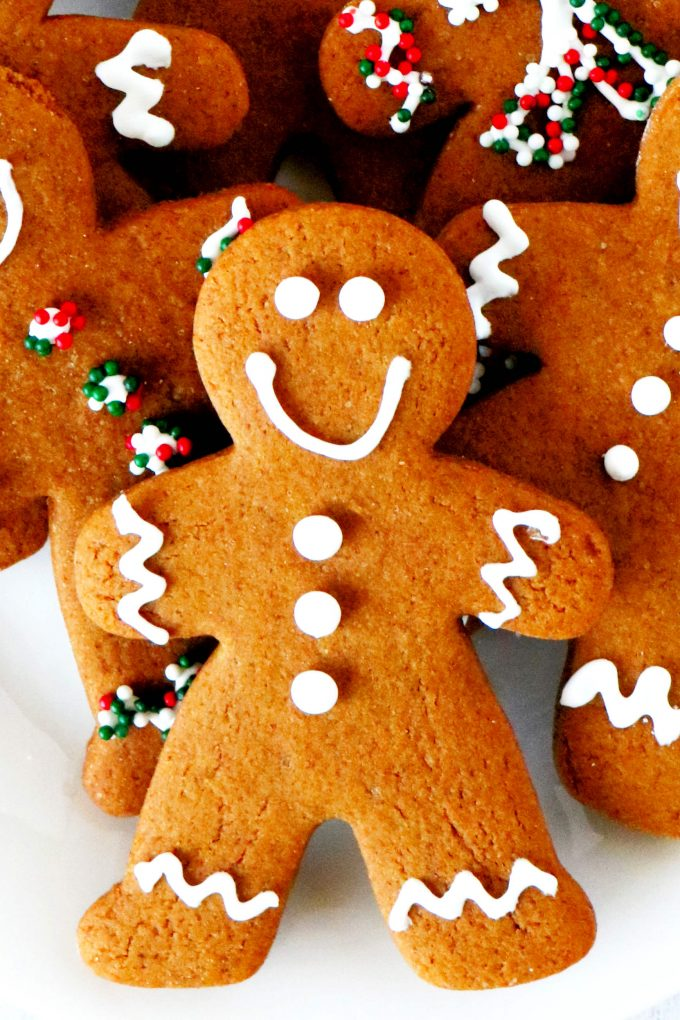 A close up, overhead shot of decorated gingerbread cookies on a plate.