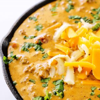 A close up shot of chili cheese dip in a skillet.
