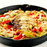 Cajun Chicken Alfredo Pasta in a cast iron pan.