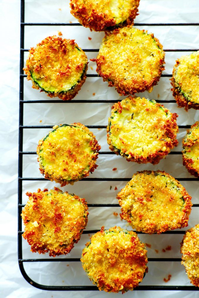An overhead shot of air fryer zucchini chips on a cooling rack.