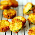 Air fryer zucchini chips on a cooling rack.