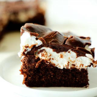 A marshmallow brownie on a white plate.