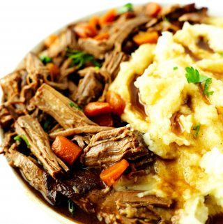 Slow cooker rump roast and mashed potatoes in a bowl.